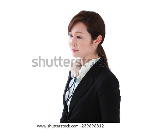 Professional woman in a business suit listening intently  - stock photo