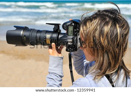 professional woman photographer on the beach