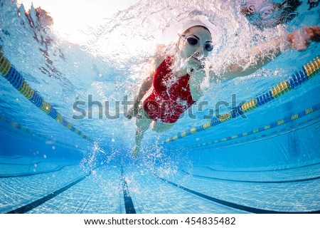Professional woman swimmer inside swimming pool. - stock photo