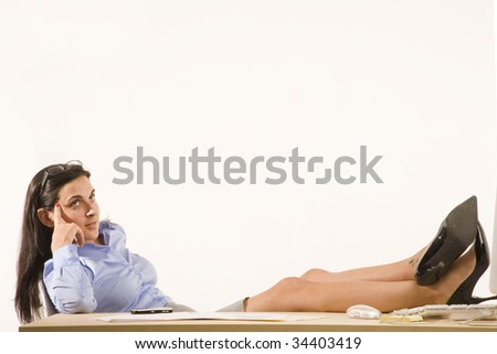 professional woman with feet up on desk