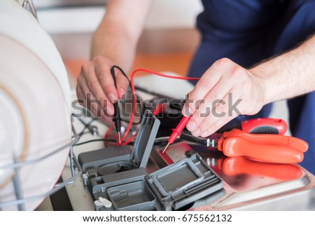 dishwasher repair stock images
