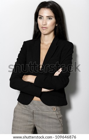 Professional working woman in corporate business suit - stock photo