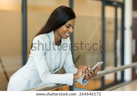professional young african career woman using smart phone - stock photo