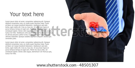 Professionally dressed businessman is giving a present credit card - stock photo