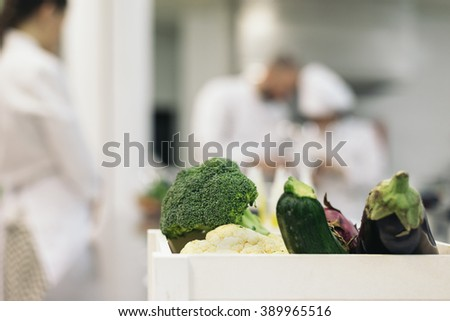 Professionals chefs cooking together in a kitchen. - stock photo