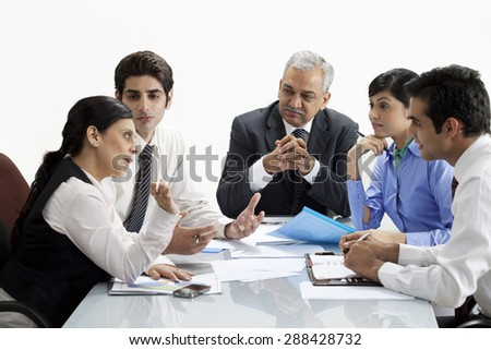 Professionals discussing together in a meeting