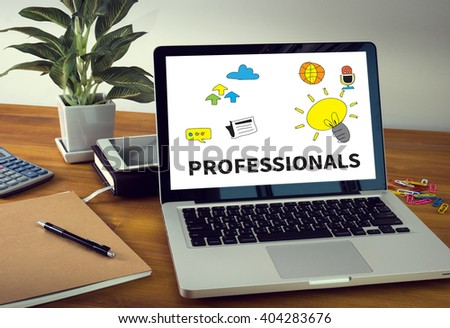 PROFESSIONALS Laptop on table. Warm tone - stock photo