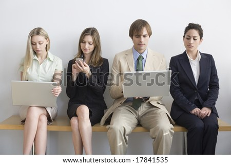 Professionals waiting on bench - stock photo