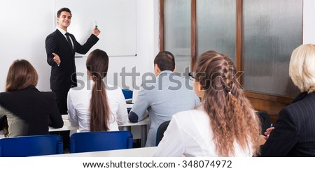 Professor and adult professionals at extension business courses  - stock photo