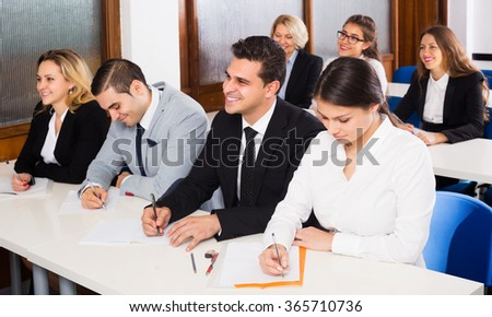 Professor and positive students at extension business courses - stock photo