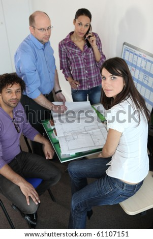 Professor and students in architecture - stock photo