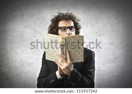 Professor reading a book - stock photo