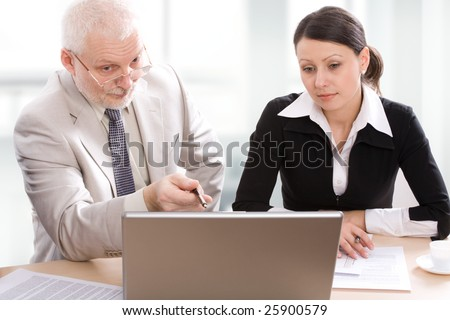 Professor teaches a student - stock photo