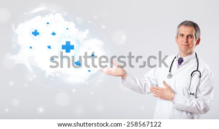 Proffesional doctor listening to abstract cloud with medical signs - stock photo