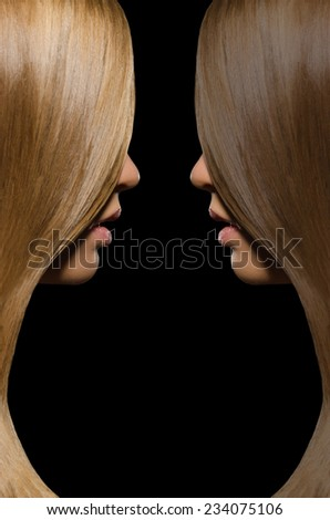 Profile blondes and brunettes with straight hair on black background - stock photo