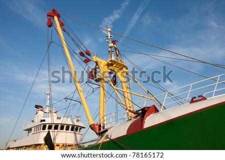 Profile of a big Dutch iron fishing cutter - stock photo