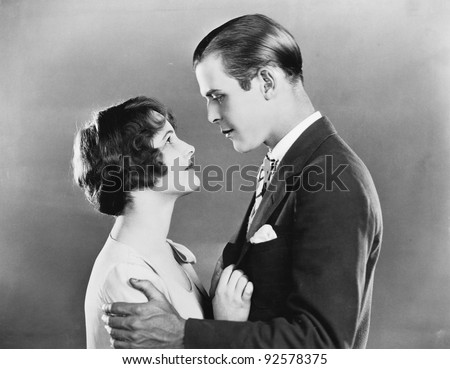 Profile of a couple romancing - stock photo