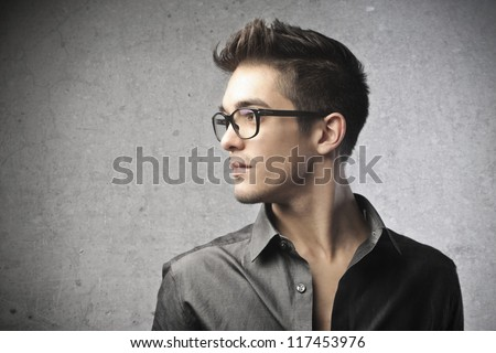 Profile of a guy with glasses - stock photo