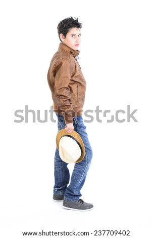 Profile of a handsome young boy holding a hat - stock photo