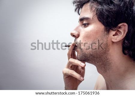 Profile of a person smoking - stock photo