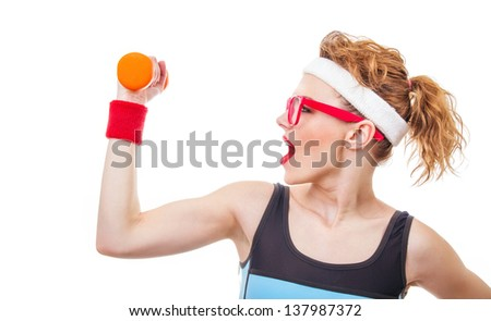 Profile of a woman with dumbbell, close-up of fitness girl - stock photo