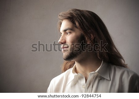Profile of a young man with long hair - stock photo