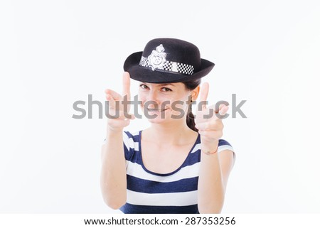 Profile of a young smiling woman holding hands as guns - isolated on white - stock photo