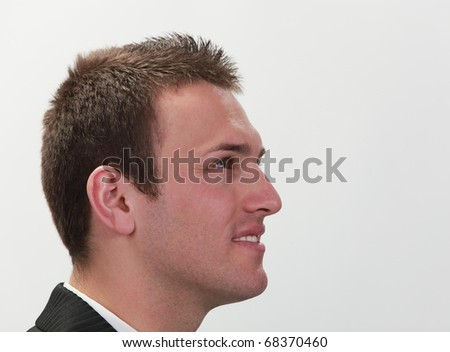 Profile of a young successful businessman. - stock photo