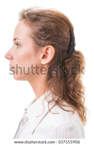 profile of a young woman close up on white background - stock photo