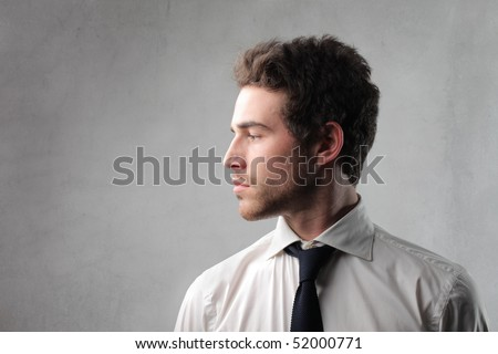 Profile of an attractive businessman - stock photo