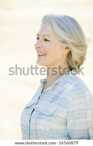 Profile of an Attractive Woman Standing Outdoors - stock photo