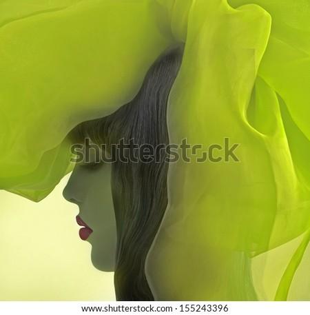 Profile of beautiful girl with fantasy green drapery.  - stock photo