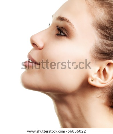 Profile of beautiful woman with clear skin - stock photo