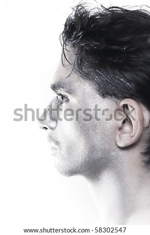 Profile of beautiful young guy with silver makeup isolated on white background