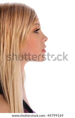 Profile of beautiful young woman isolated over white background - stock photo