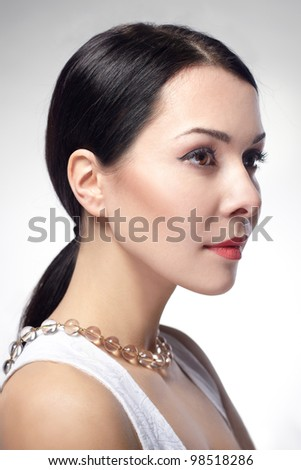 Profile of beautiful young woman's face with clean healthy skin - stock photo