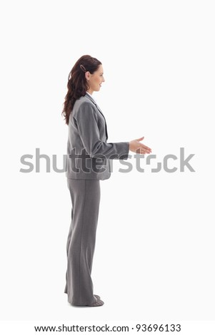 Profile of businesswoman shaking hands against white background - stock photo