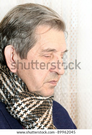 Profile of elderly man with scarf dreaming