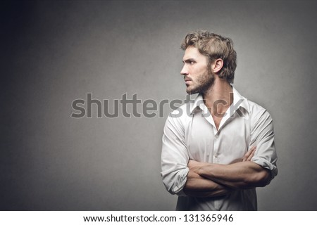 profile of handsome man on gray background - stock photo