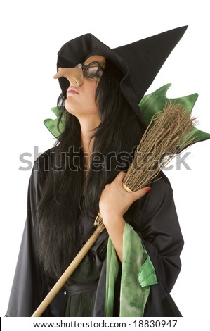 profile of old ugly witch with big nose and glasses arming a broom - stock photo