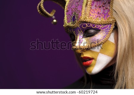 profile of pretty woman closed eyes in violet half-mask - stock photo
