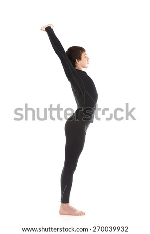 Profile of sporty young man stretching on white background, warming up, doing exercise for spine and shoulders - stock photo