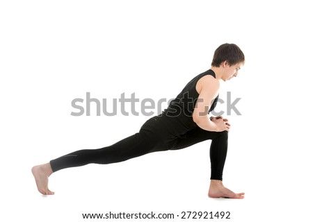 Profile of sporty young man warming up, stretching, standing in high lunge exercise, Equestrian yoga pose, Ashwa Sanchalanasana