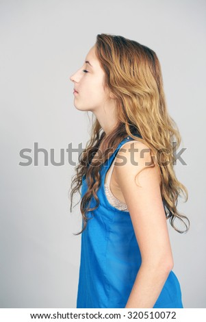 profile of teen girl with wavy hair and eyes closed