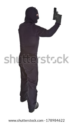 Profile of thief with gun over white background - stock photo