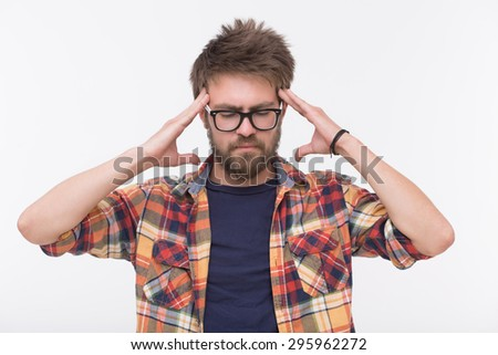 Profile of thinking dearded man. Man in glasses closed his eyes, he is touching his head with two hands isolated on white.  - stock photo