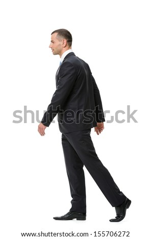Profile of walking businessman, isolated on white. Concept of leadership and success