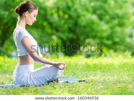 Profile of woman who sits in lotus position zen gesturing. Concept of healthy lifestyle and relaxation
