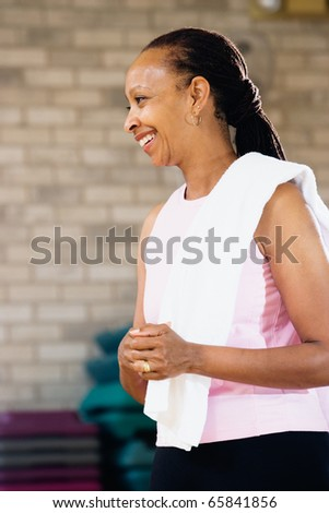 Profile of woman with towel on shoulder - stock photo