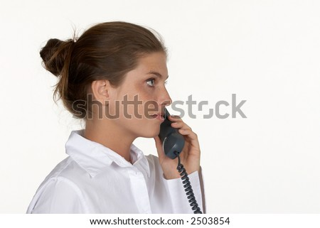 Profile of Young Woman on Phone - stock photo